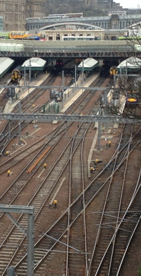 Busy railway station with buses traversing the railway via Victorian bridges